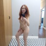 British redhead loves posing naked on cam